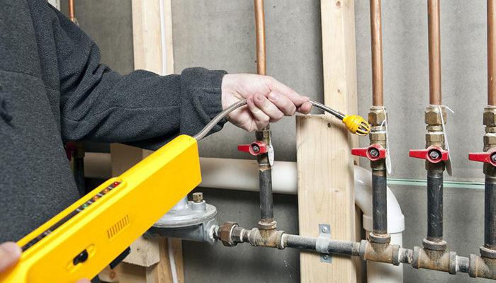 gas-leak-detector-being-used-on-pipes-in-a-home